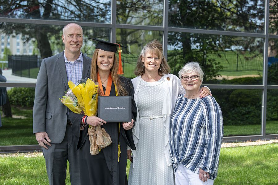 Class of 2021's Emma Wolf with her mother, father and grandmother