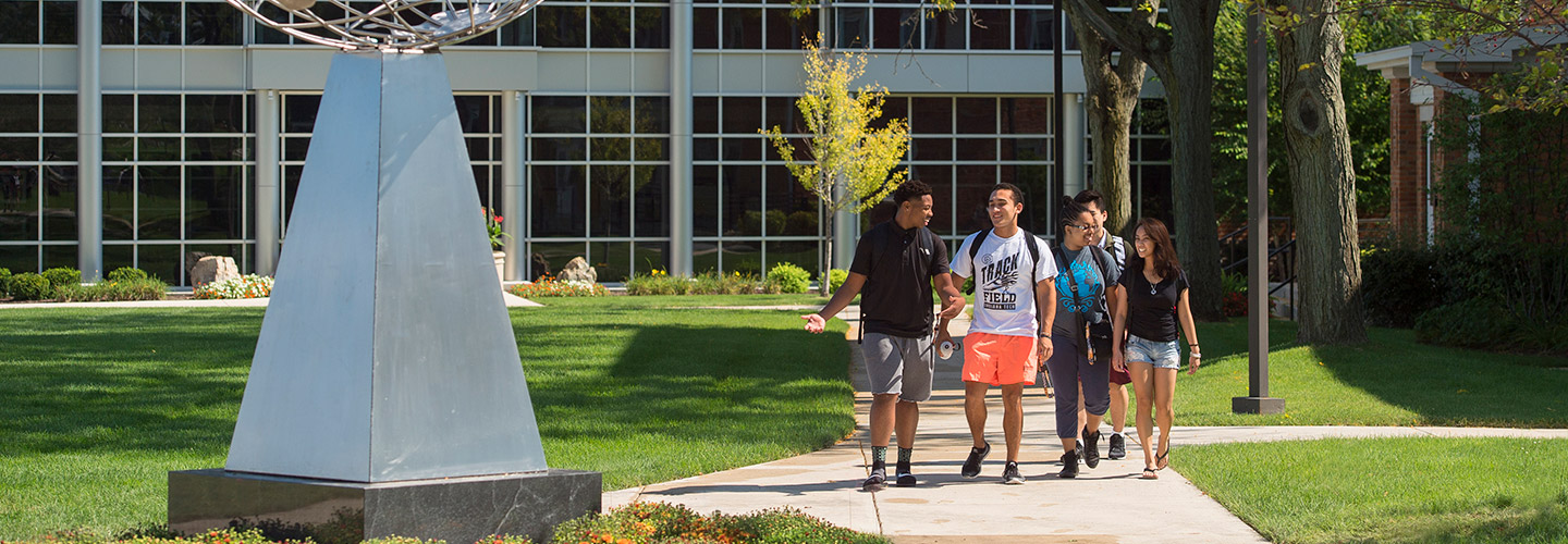 Students walking across campus in a group
